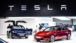 Tesla automobiles in showroom - certain agencies rate fossil-fuel giant Exxon Mobil and EV maker Tesla the same for ESG
