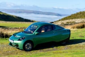 Riversimple Rasa hydrogen car, pictured in green in Welsh countryside