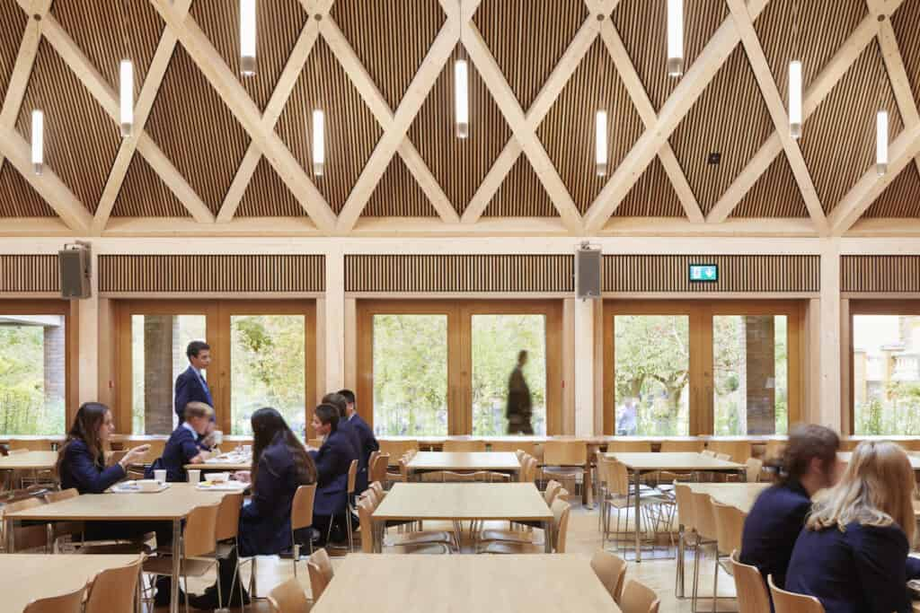 View looking out of windows from timber interior of school refectory