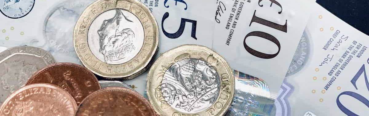 Notes and coins signifying profit for UK construction