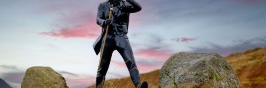 Promotional statue of Johnnie Walker Striding Man in outdoor mountain setting