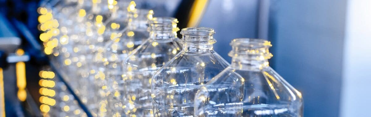 Row of plastic bottles on a factory production line