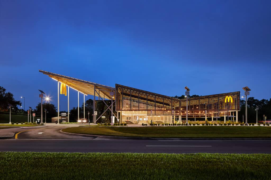 Side elevation showing Kebony louvred exterior of McDonald's Flagship-Disney restaurant, in Orlando (at night)
