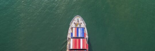 Aerial view of container shipping by sea.
