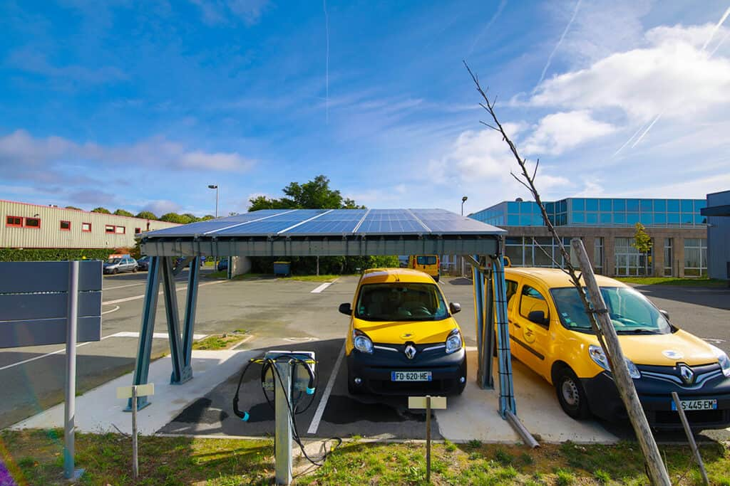 La Poste delivery vehicles at solar charging tests station for 'Buildings as a Grid' concept created by Eaton