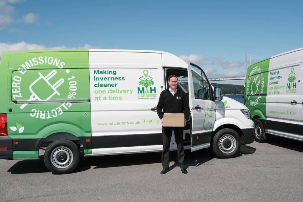 Fraser MacLean, managing director of M&H Carriers, with the new Highland electric delivery fleet