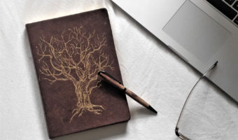 Leather journal with golden tree image: Journaling daily | nextlevelwarrior.com