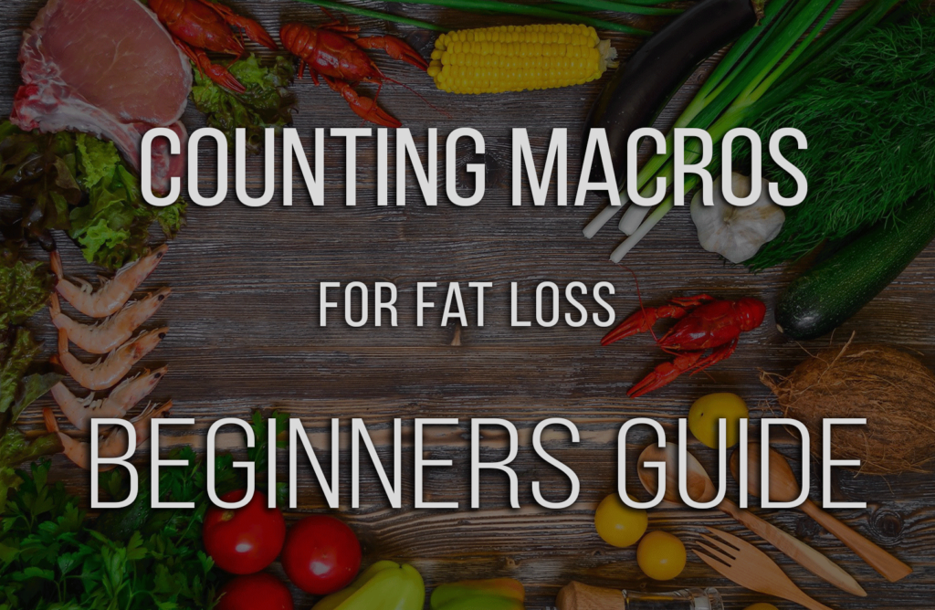 wooden table full of a variety of food with the title counting macros for fat loss