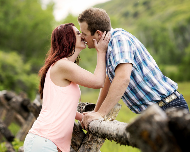 Utah Engagement Pictures kiss bokeh smile