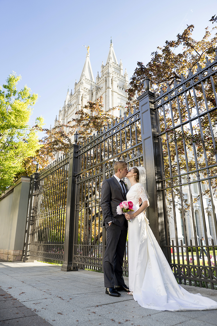 Salt Lake Temple Groom kissing bride