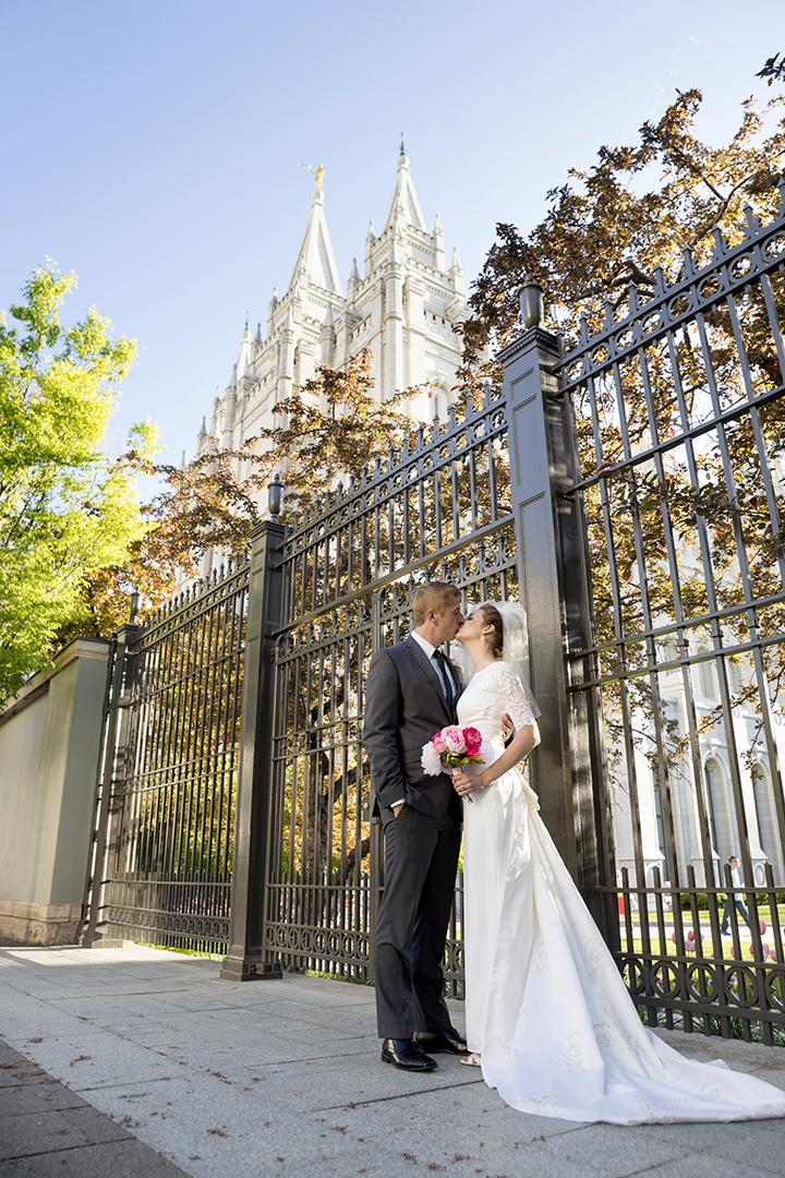 Salt Lake Temple Groom kissing bride