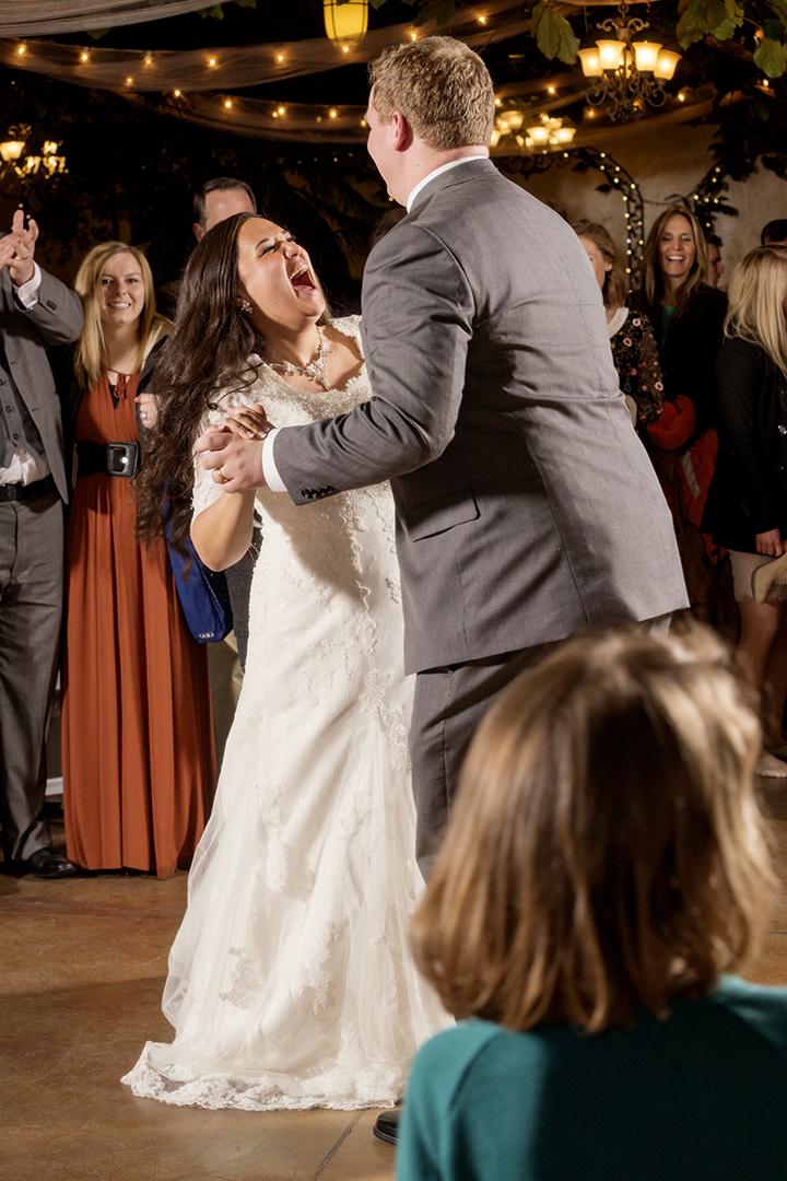 Bride Laughing during First Dance at Wedding