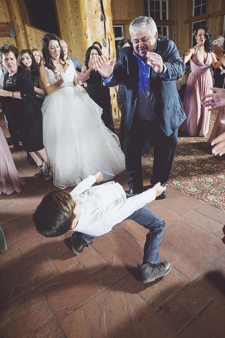 Kid tears up dance floor at wedding