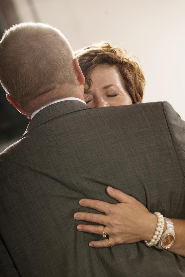 Parents embrace at wedding