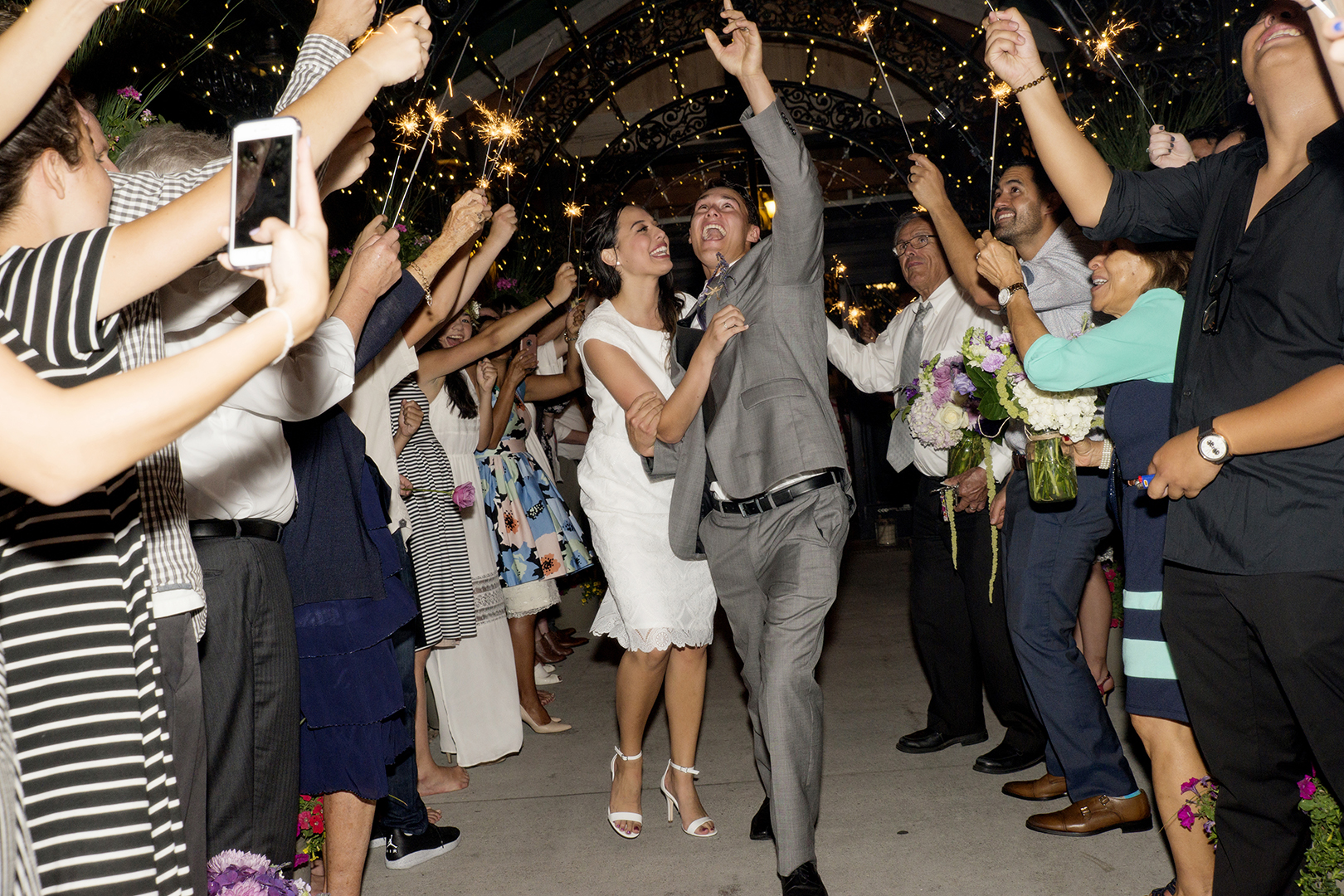 Excited Wedding Couple Exits to sparklers