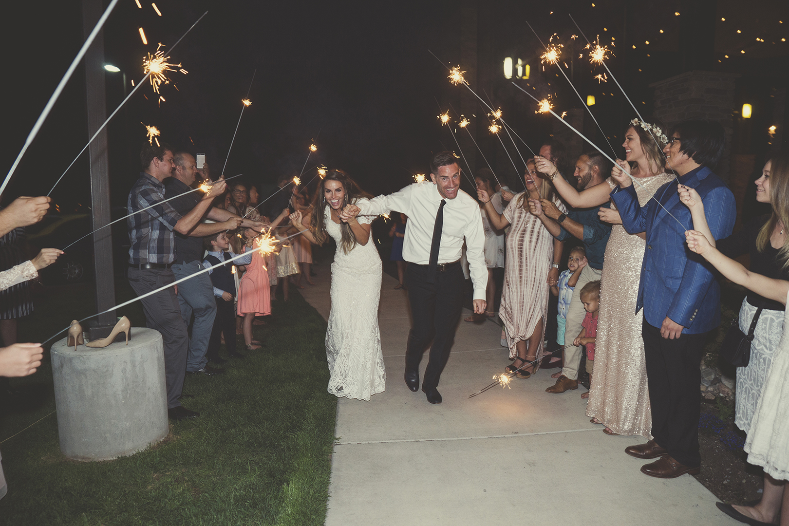 Bride and Groom Running through sparklers at wedding