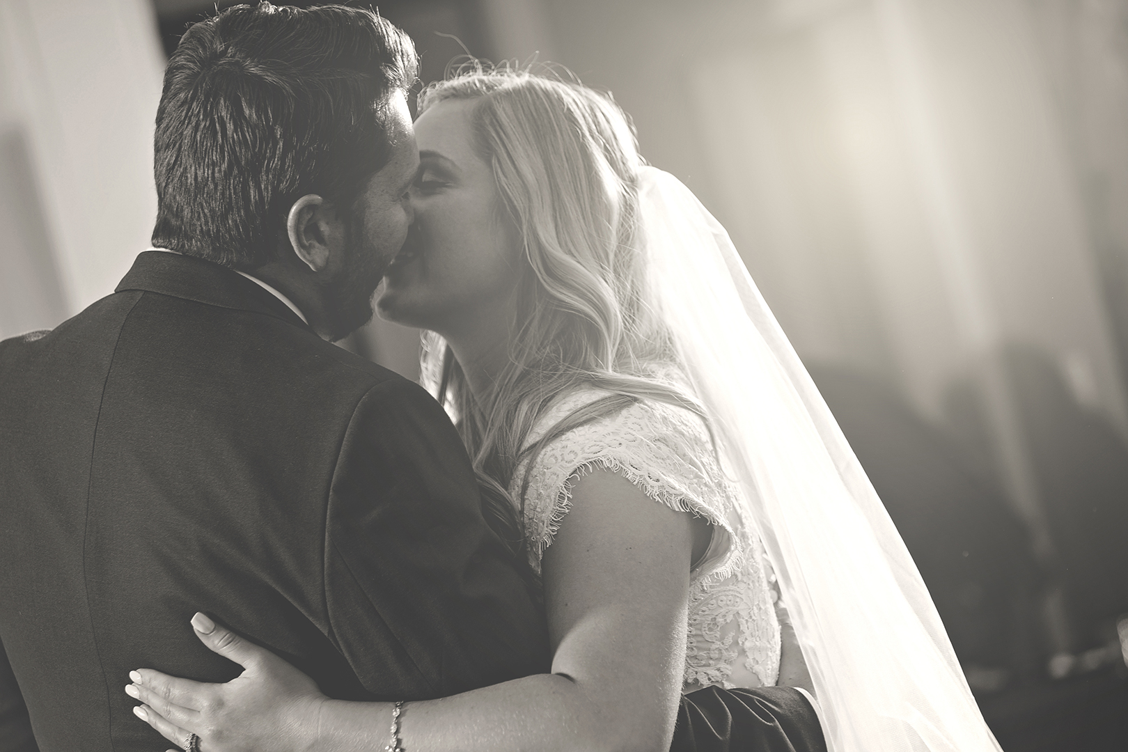 Black and white first dance kiss