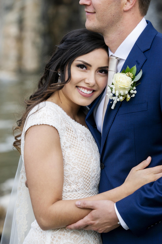 Bride smiling holding Groom