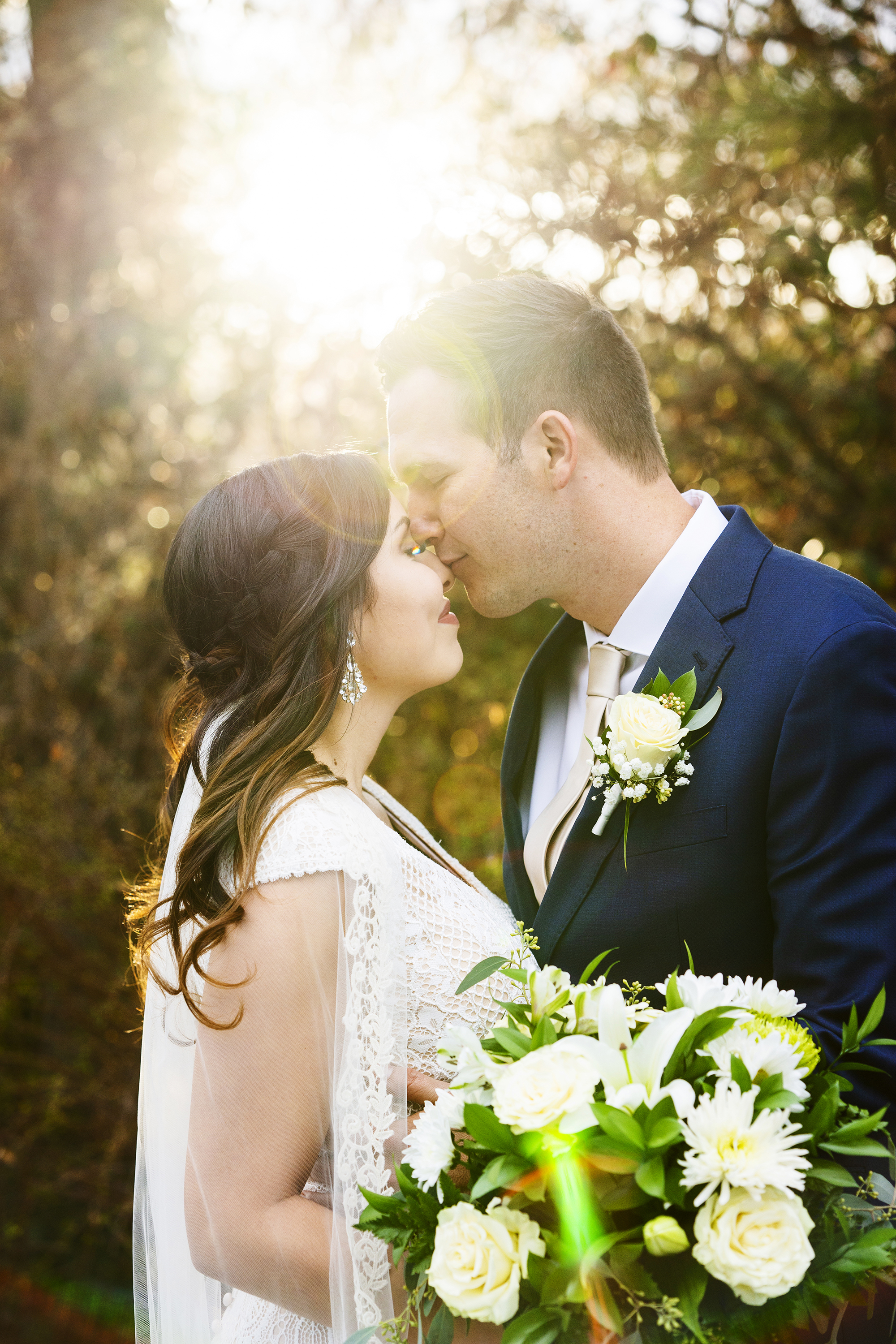Bride and Groom Kissing Sunflare