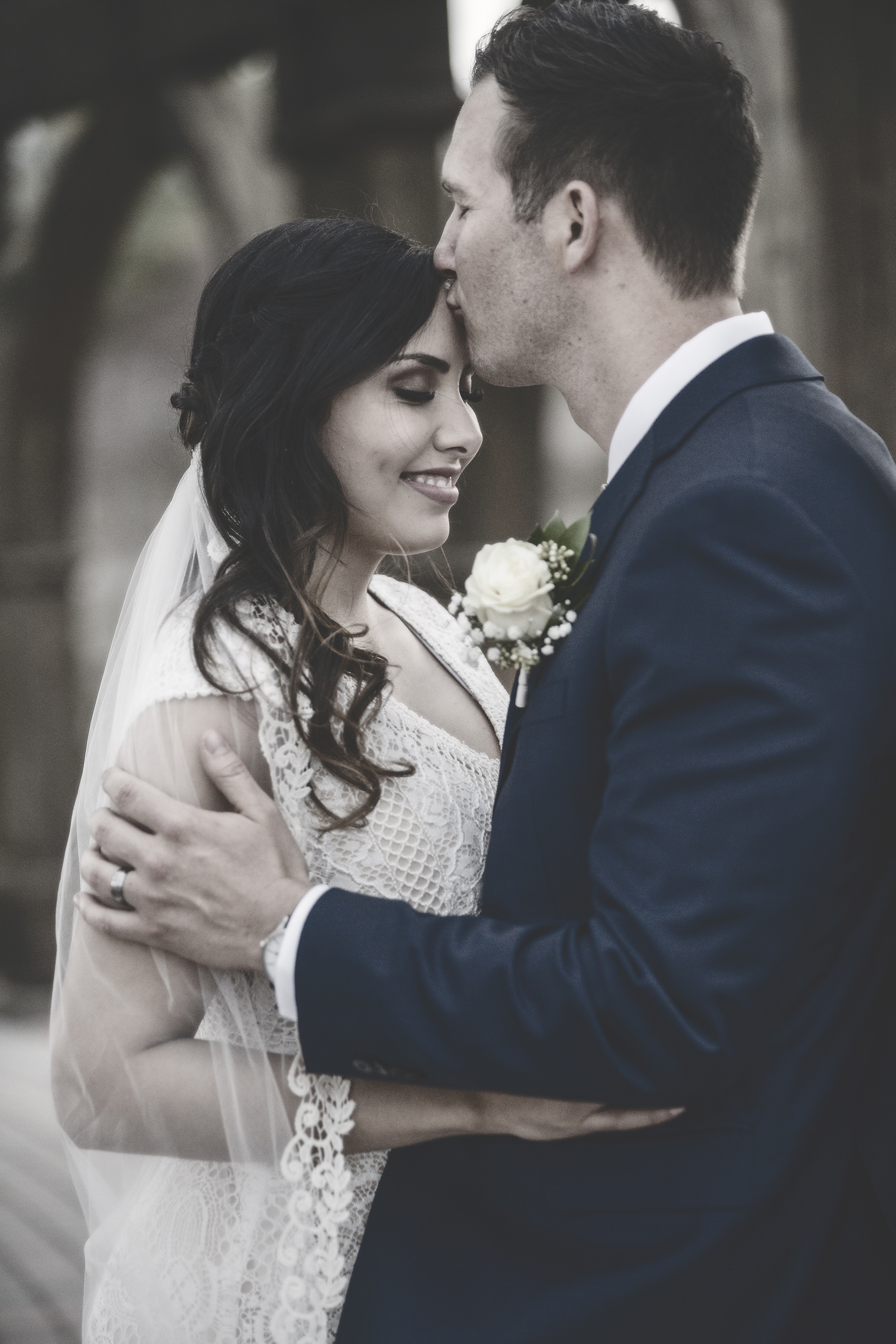 Bride and Groom soft color kiss