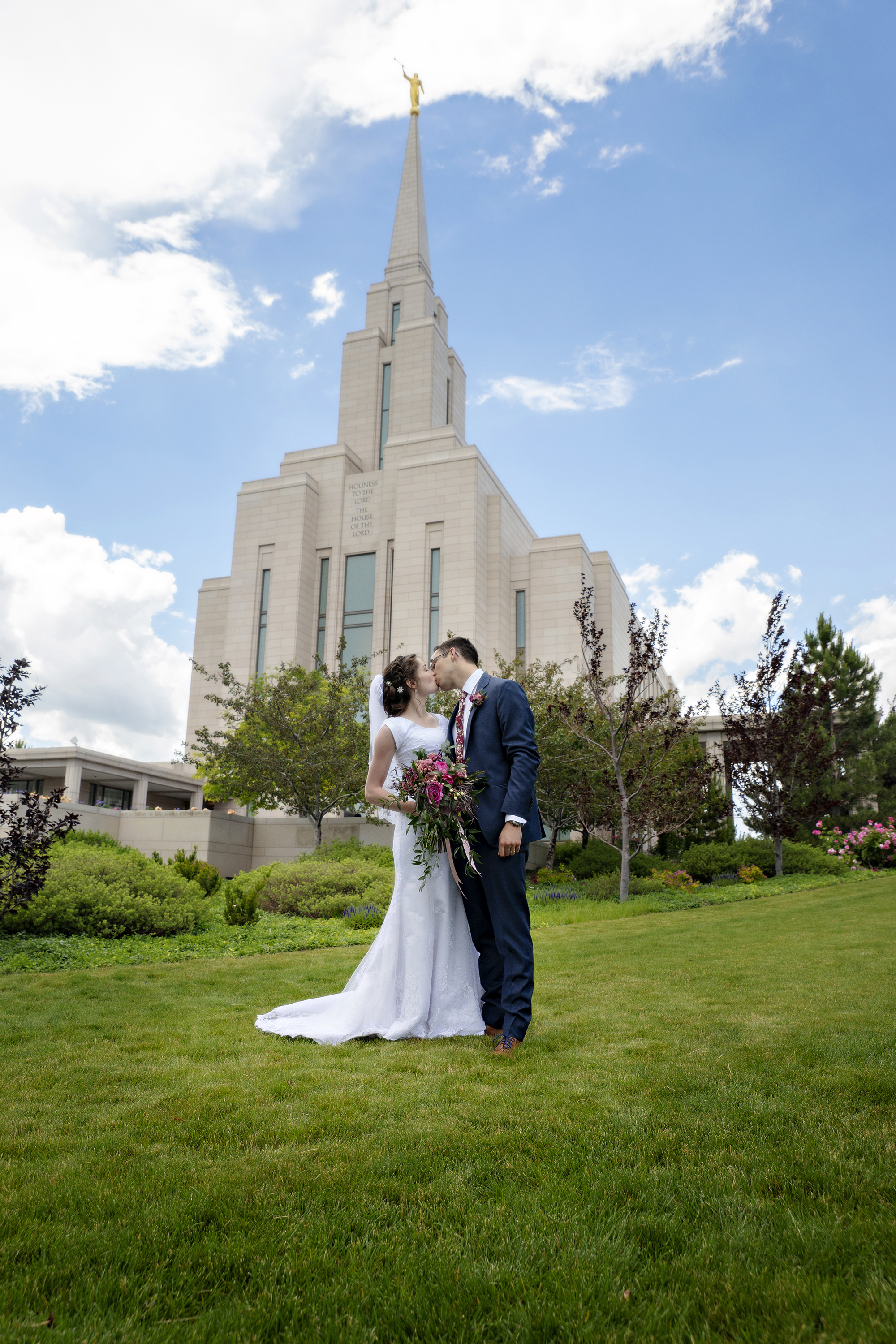 Bride and Groom kissing at Oquirrh Mountain Temple