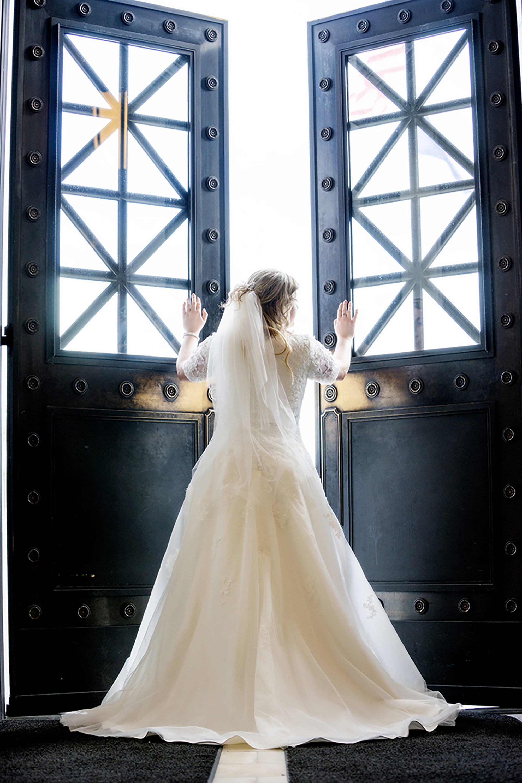 Bride opening doors