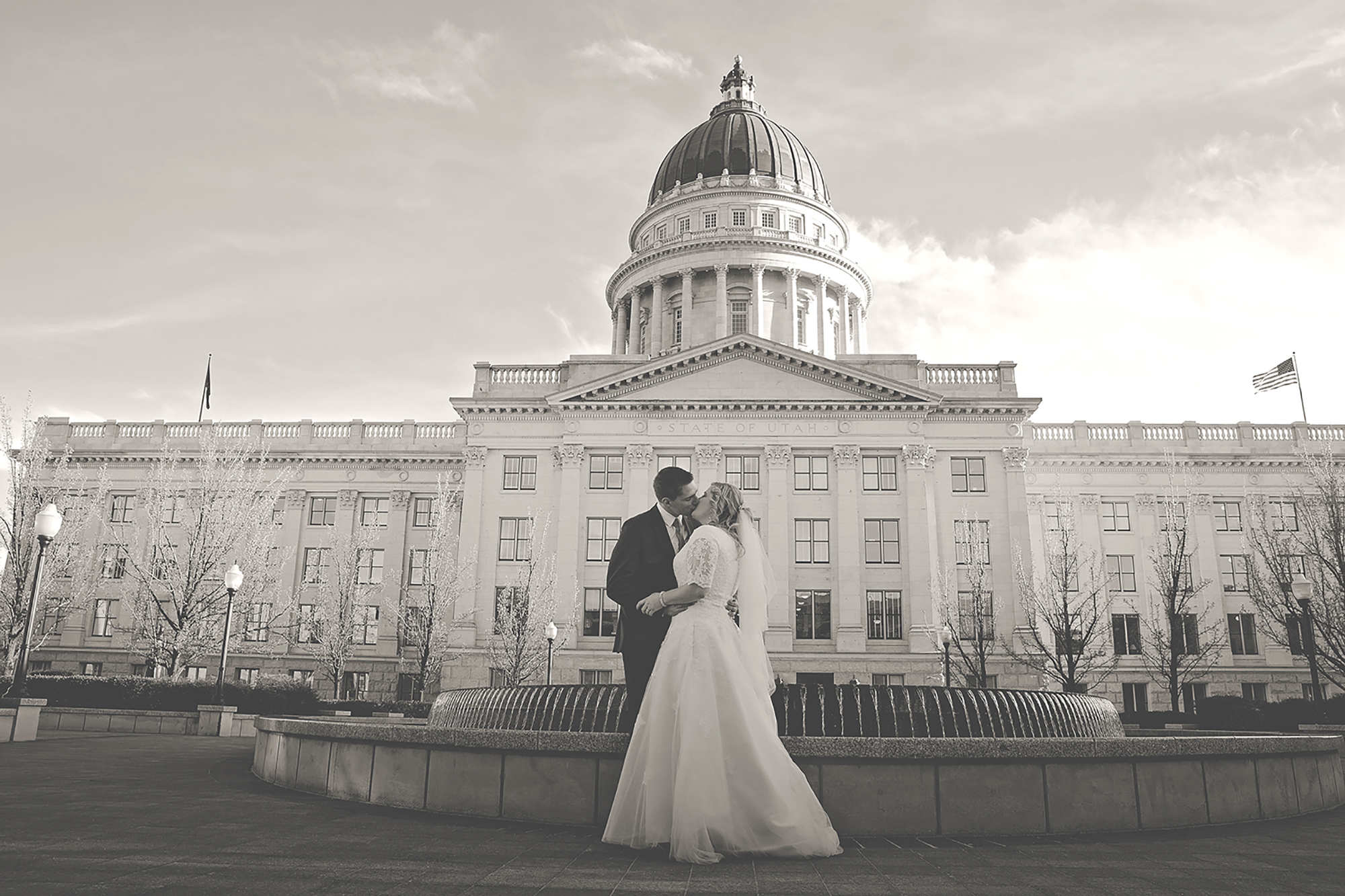 Bride and Groom kissing at Salt Lake Capitol Building