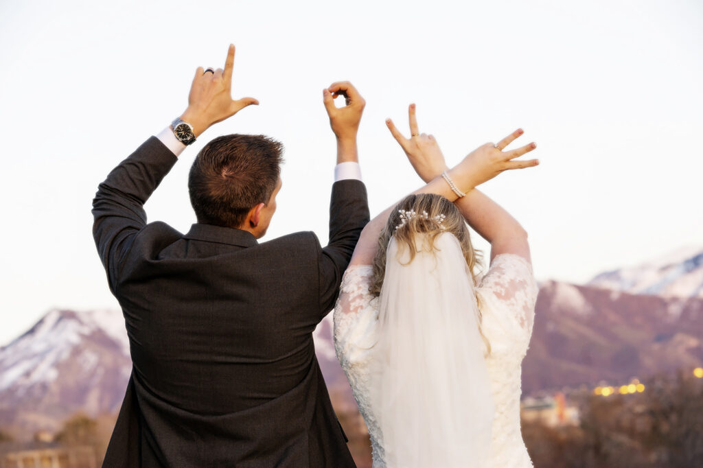 Bride and Groom making Love Sign with hands
