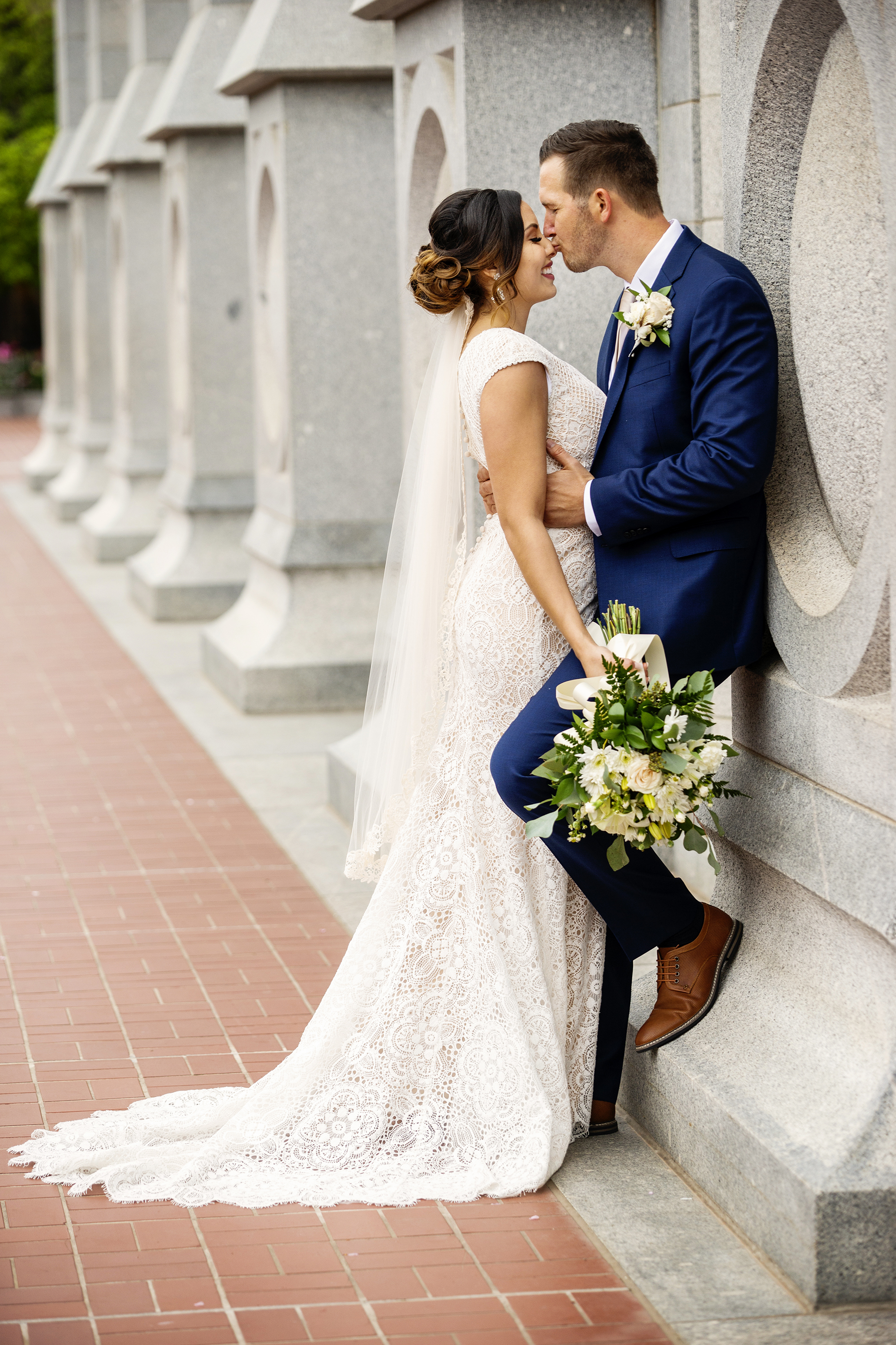 Groom kissing bride and nose