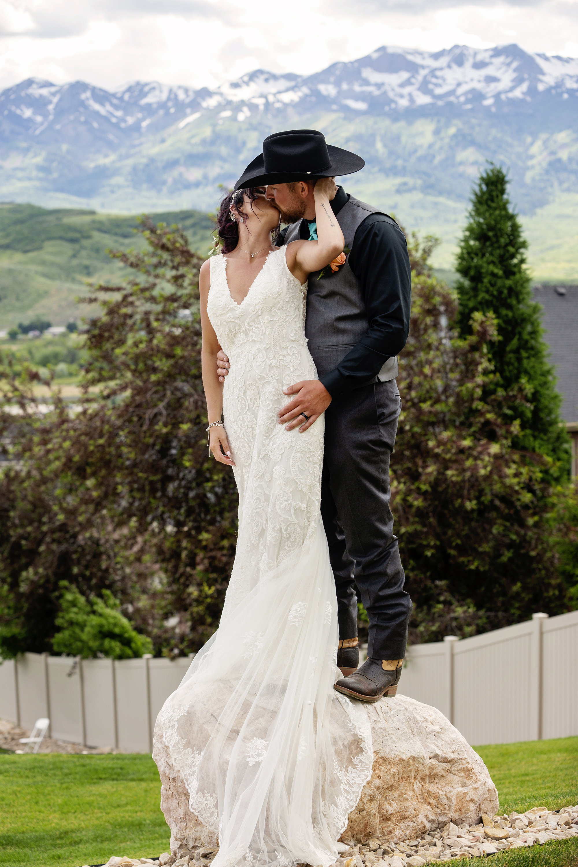 Bride and Groom kissing with Rocky Mountain view
