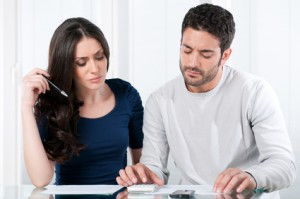 Worried couple with bills
