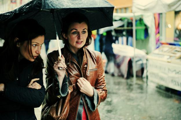 women in rain