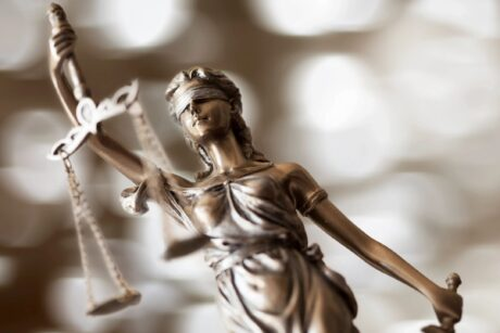 woman statue holding justice scale