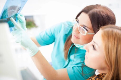 two women in dental office reviewing xray