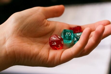 woman's hand holding dice