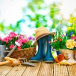 garden tools including boots, watering can, flower pots, flowers, tools and sun hat