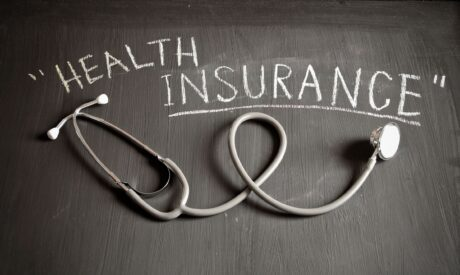 stethascope with words health insurance printed above