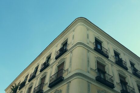 top outer corner view of historical apartment building