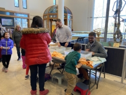 Jared Gentilucci and Brian Creamer show kids how to build boats that will float