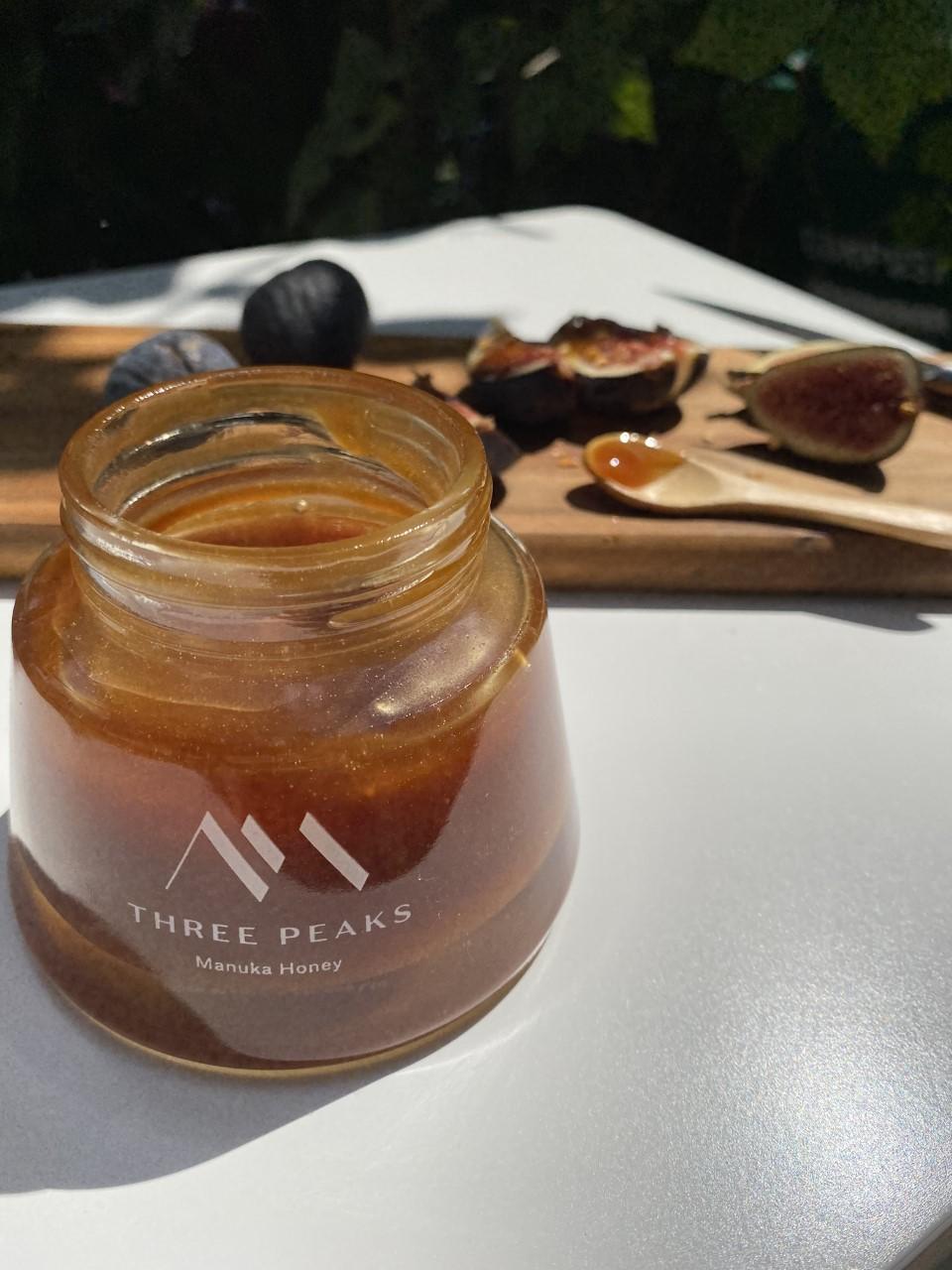 close up of Three Peaks Honey jar