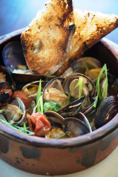 Wood Oven Clams with Sake Butter, Padrones and Cherry Tomatoes