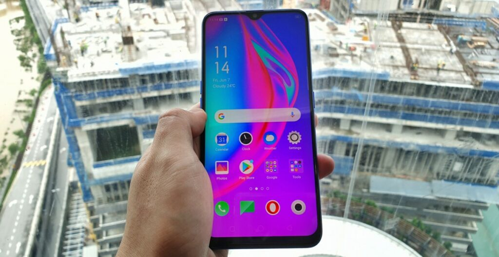 OPPO F11 with hands