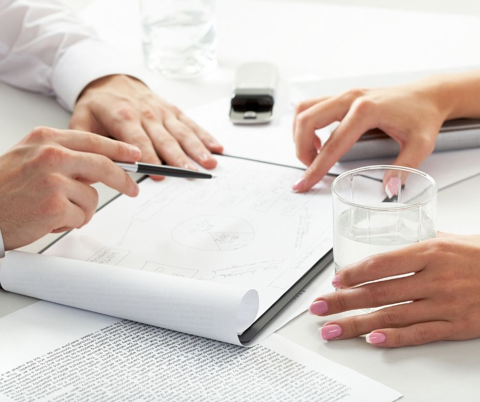 man and woman consulting over paperwork