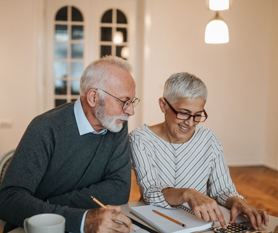 senior man and woman looking over paperwork