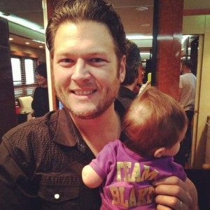 Blake Shelton holds a cute baby