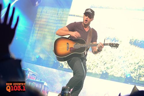 Luke Bryan shares a beer with a lucky fan