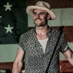 Sam Hunt in front of an American Flag