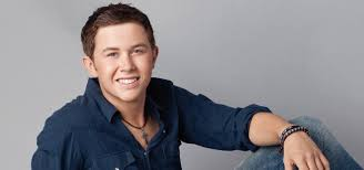 Scotty McCreery sings with the children's choir at his old elementary school