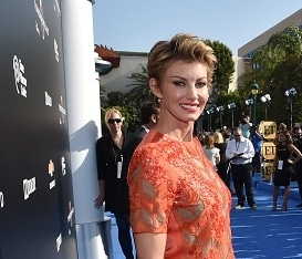 "Faith Hill looks amazing in orange at the ""Tomorrowland"" premiere"