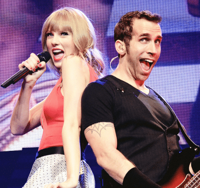 Taylor Swift band member, Amos Heller, clears up some confusion…sort of.
